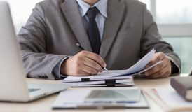 Businessman working reading documents graph financial to job suc Royalty Free Stock Image