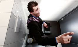 businessman working in restroom Royalty Free Stock Images