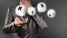 Businessman working on risk management Stock Photo