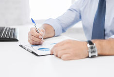 Businessman working and signing papers Royalty Free Stock Photos