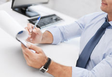 Businessman working and signing papers Royalty Free Stock Image