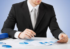 Businessman working and signing with papers Stock Photo