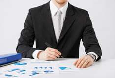 Businessman working and signing with papers Stock Photos
