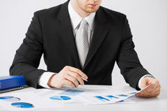 Businessman working and signing with papers Royalty Free Stock Image