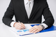Businessman working and signing papers Stock Image