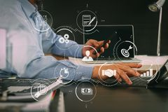 Businessman working with smart phone and digital tablet and lapt. Business process management with workflow automation diagram and gears in virtual flowchart Royalty Free Stock Images