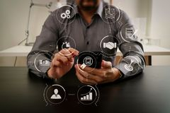 Businessman working with smart phone and digital tablet and lapt. Business process management with workflow automation diagram and gears in virtual flowchart Stock Photography
