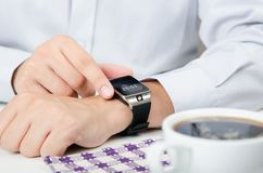 Businessman working with smart watch in restaurant Royalty Free Stock Photos