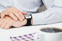 Businessman working with smart watch in restaurant Stock Photography
