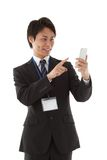 Businessman working with smartphone Royalty Free Stock Photos