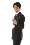 Businessman working with smartphone Royalty Free Stock Photography