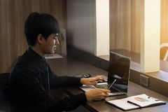 Businessman are working with smartphone and notebook stock photography