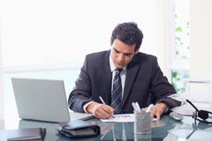 Businessman working on statistics Stock Image