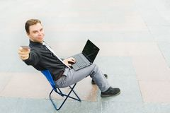 A businessman working on the street Royalty Free Stock Photos