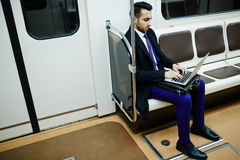 Businessman Working in Subway Train stock images
