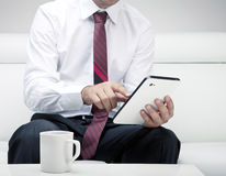 Businessman working on tablet Stock Photo