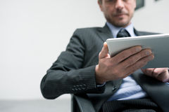 Businessman working with tablet Royalty Free Stock Photography