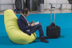 Businessman working on tablet at Bit 2015, international tourism exchange in Milan, Italy Stock Photos