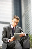 Businessman Working On Tablet Computer. Outside Office Stock Images