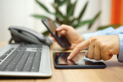 Businessman is working with tablet computer and smart mobile pho Royalty Free Stock Photos
