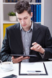 Businessman working on tablet Royalty Free Stock Photo