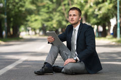 Businessman Working On Tablet Outside The Office Stock Image