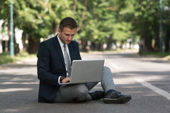 Businessman Working On Tablet Outside The Office Stock Photo
