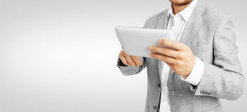 Businessman working a tablet PC -Clipping Path. Human hands working on digital tablet Royalty Free Stock Image