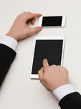 Businessman working with tablet pc and smartphone Stock Photo