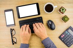 Businessman working with tablet and smartphone on office desk . royalty free stock images
