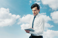 Businessman working. With touchpad blue sky Stock Photography