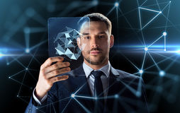 Businessman working with transparent tablet pc Stock Photo