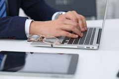 Businessman working by typing on laptop computer. Man`s hands on notebook or business person at workplace. Employment  o. R start-up concept Stock Photography