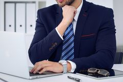 Businessman working by typing on laptop computer. Man`s hands on notebook or business person at workplace. Employment  o. R start-up concept Royalty Free Stock Photos
