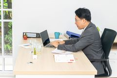 Businessman are working. Businessman are using a laptop computer to work stock images