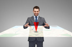 Businessman working with virtual gps navigator map. Business, technology and people concept - smiling businessman working with virtual gps navigator map Royalty Free Stock Photos