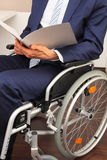 Businessman working in a wheelchair Stock Photography