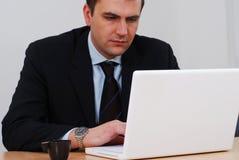 Businessman working on white computer Stock Photos