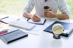 Businessman working writing making note business plan and graphic designer with computer in office.  royalty free stock photo
