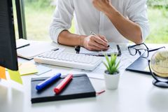 Businessman working writing making note business plan and graphic designer with computer in office.  stock photos