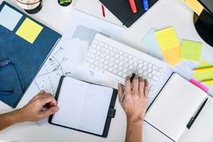 Businessman working writing making note business plan and graphic designer with computer in office, top view workspace.  stock images