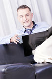 Businessman working in your home. stock photo
