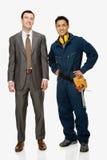 Businessman and workman Stock Photos