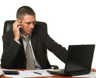 The businessman on the workplace Stock Photography