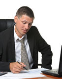 The businessman on the workplace Stock Image