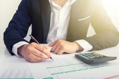 Businessman at the workplace. Working with documents and calculator Royalty Free Stock Photography