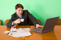 Businessman on a workplace with the laptop Stock Photo