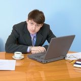 Businessman on a workplace with the laptop Royalty Free Stock Photo