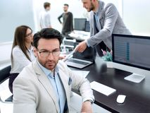 Businessman in the workplace in the office royalty free stock photography