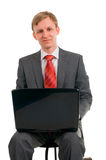 Businessman works. The businessman works behind the computer Stock Photography